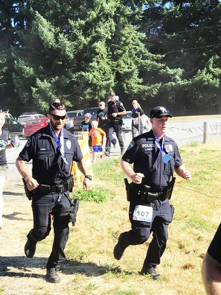 PHOTO CREDIT: RALPH PAINTER MEMORIAL 10K, 5K AND KIDS RACE - Officer Craig Teschlog, 42, of Monroe, Wash., and the Lake Forest Park Police Department (107) runs in the kids race.