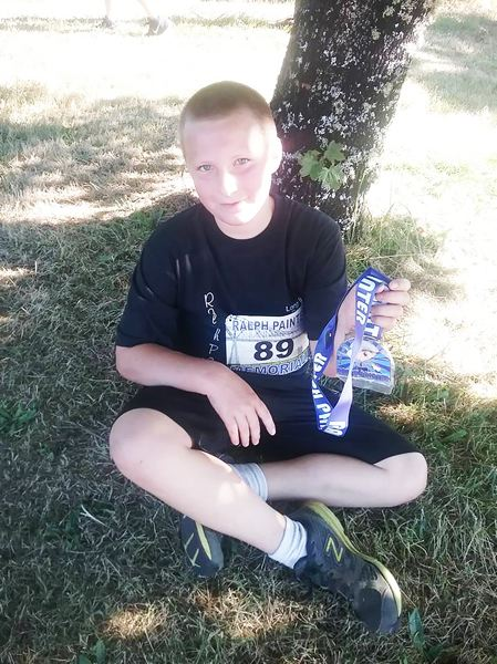 PHOTO CREDIT: RALPH PAINTER MEMORIAL 10K, 5K AND KIDS RACE - Ethan Wedam, 10, of Battle Ground, Wash., shows off his Ralph Painter Memorial 10k, 5k and Kids Race lanyard.