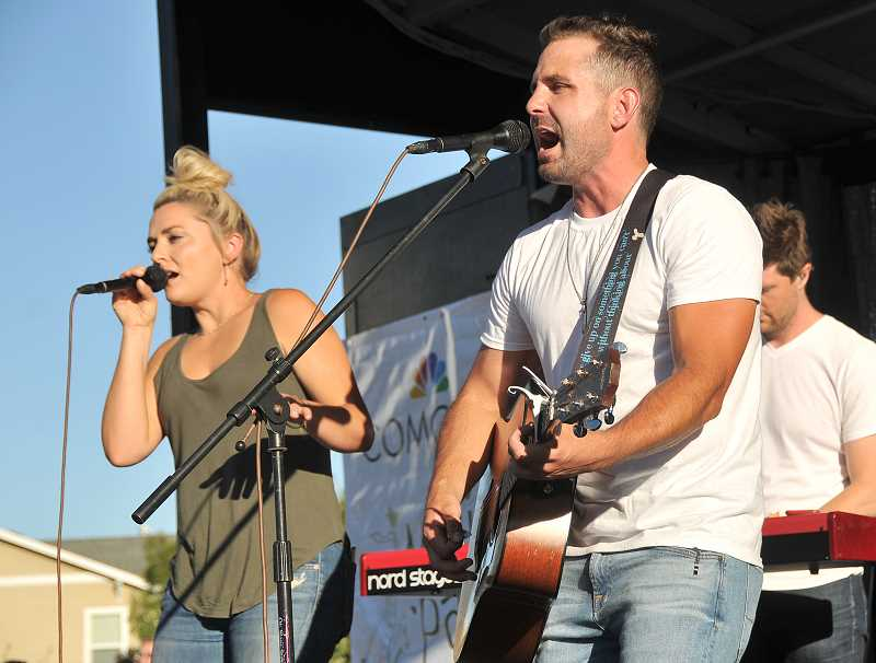 TIDINGS PHOTOS: VERN UYETAKE - Nate Botsford, right, and his band perform to the large crowd at the July 27 Music in the Park at Tanner Creek Park.