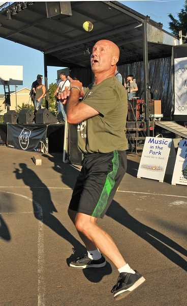 Mag Hughes practices his footbag skills as he listens to the concert.