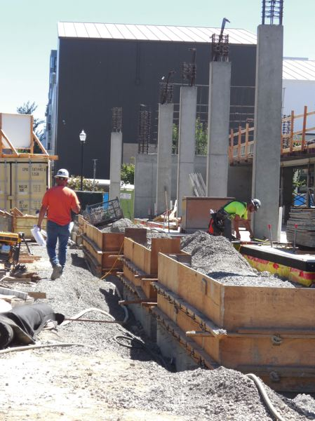 PAMPLIN MEDIA GROUP: JOSEPH GALLIVAN  - Meining and Phelps were building wooden forms in direct sunlight in preparation for a concrete pour. They were drinking plenty of water and looking forward to a 6 a.m. start the rest of the week, to gain an hour of cooler temperatures.