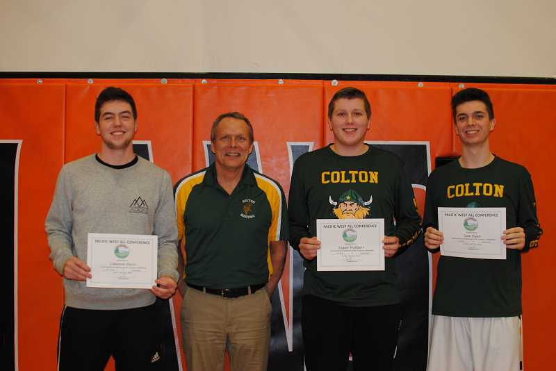 PIONEER FILE PHOTO - Former Colton High School athletic director and head boys' basketball coach Greg Adams (left middle) has resigned from both positions recently. In this photo, Adams stands with Colton Class of 2017 seniors Cameron Davis, Logan Wallaert, and Sam Ryan as they received their All-League awards.