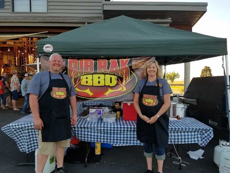 SUBMITTED PHOTO - Lyle and Laura Rehwinkel are ready to serve barbecue.