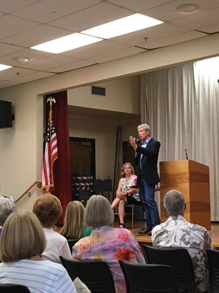 PAMPLIN MEDIA GROUP: PETER WONG - U.S. Rep. Kurt Schrader speaks at a town hall meeting attended by 150 people Tuesday, Aug. 1, at the Milwaukie Center. Seated next to him is Clackamas County Commissioner Sonya Fischer.