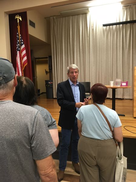 PAMPLIN MEDIA GROUP: PETER WONG - U.S. Rep. Kurt Schrader speaks to a constituent after a town hall meeting Tuesday, Aug. 1, at the Milwaukie Center.