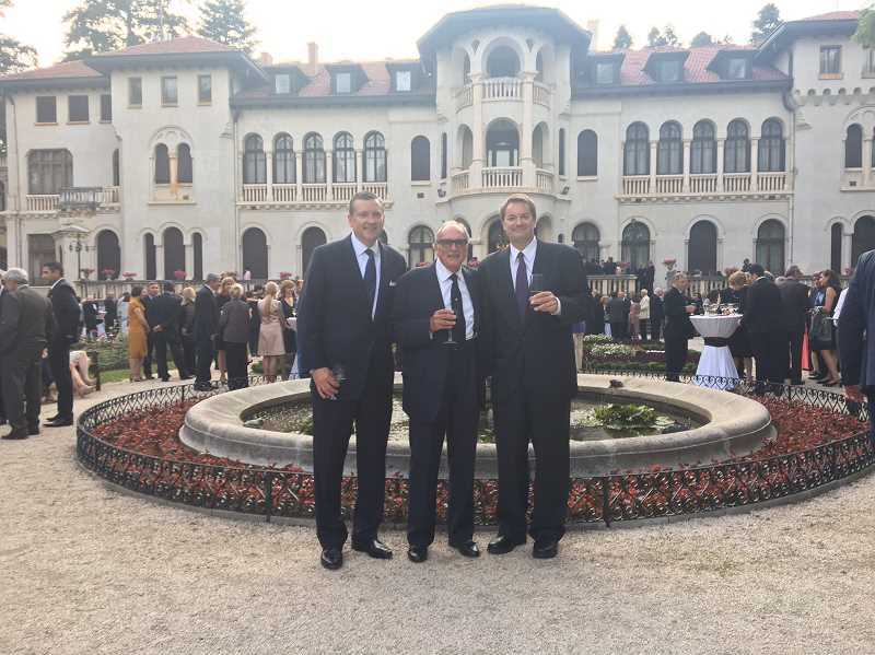 SUBMITTED PHOTO: JIM BEATTY - From left: Jame, Jim and Bob Beatty pose in the courtyard of Vrana Palace during the celebration of King Simeon IIs 80th birthday celebration on June 16.