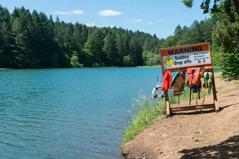 NEWS-TIMES FILE PHOTO - Remember to use the free life jackets at Hagg Lake if you are wading near sudden dropoffs or are a weak swimmer.