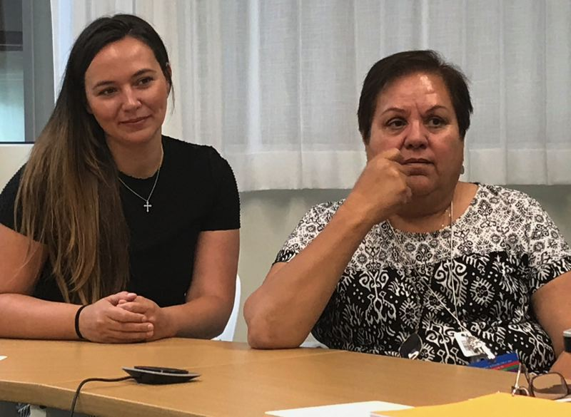 TIMES PHOTO: DANA HAYNES - Lindsay Verber, left, and Maria Loredo of the Virginia Garcia Memorial Health Center expect thousands of youths to now be eligible for health care coverage. The catch: Reaching immigrant families to let them know.