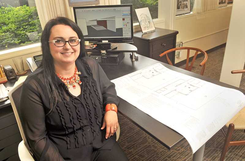 STAFF PHOTOS: VERN UYETAKE  - Ida York, principal of Ida York Design Group, moved the business to Lake Oswego in February. The transformation of the basement space into the companys inviting suite is a testament to her talents.