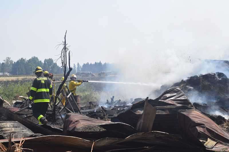 DANIEL PEARSON - A barn was demolished by the time firefighters arrived on the scene Aug. 2.
