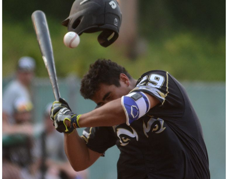 OUTLOOK PHOTO: DAVID BALL - Gresham catcher Tony Godino takes a fastball to the head that would leave his helmet cracked in the second inning of the GreyWolves 9-8 loss to Port Angeles on Wednesday.