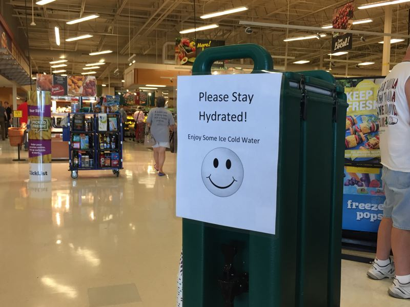 SPOTLIGHT PHOTO: NICOLE THILL - While some businesses and public agencies set up cooling centers during the heatwave from Aug. 1 to Aug. 4, others set up hydration stations, like this one in the Scappoose Fred Meyer. Temperatures peaked in the low 100s during a three-day heat wave in the Pacific Northwest.