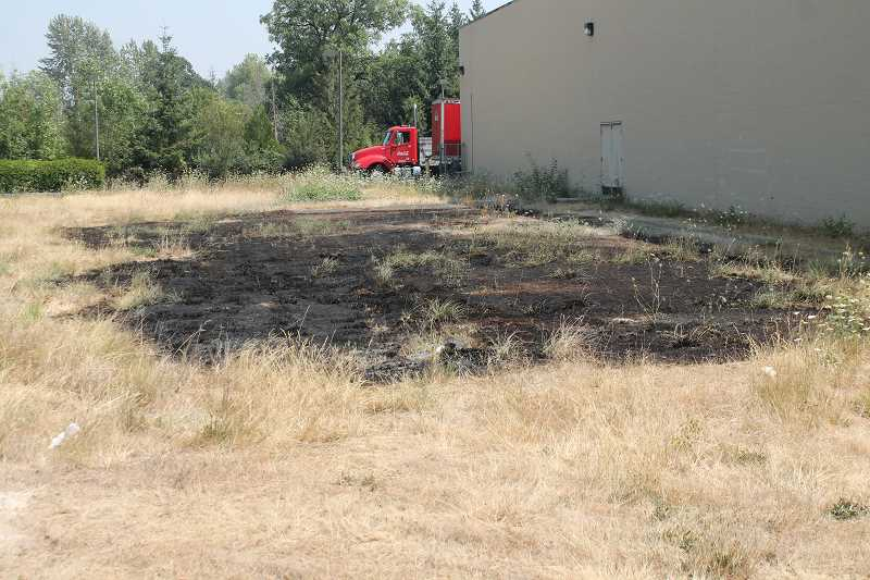 PIONEER PHOTO: CONNER WILLIAMS - A small patch of land of about 40 square feet remains charred in the grass field adjacent to the Safeway grocery store in Molalla.