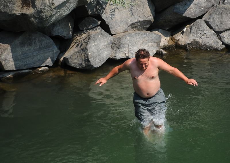 OUTLOOK PHOTO: JOSH KULLA - A man takes a dip at Glenn Otto Community Park in Troutdale.