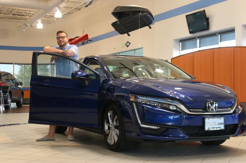 COURTESY HONDA - Brad Larsen Sanchez is the first person in Oregon to lease a 2017 Honda Clarity Electric.