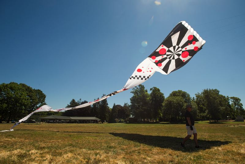 OUTLOOK PHOTO: JOSH KULLA - Hugh and Lyn Hall's kite, Toots, has a 1940s, care-free and fun look to honor Hugh's mother.
