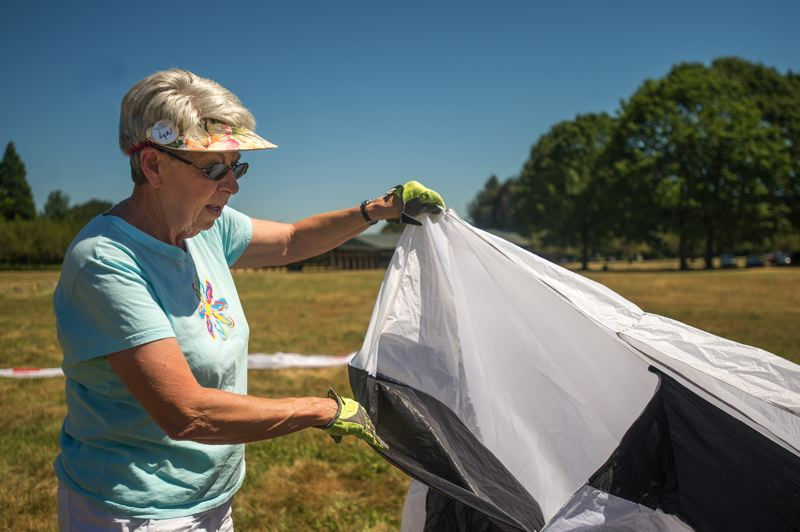 OUTLOOK PHOTO: JOSH KULLA - Lyn Hall shows where the air goes through in order to lift the kite off the ground.