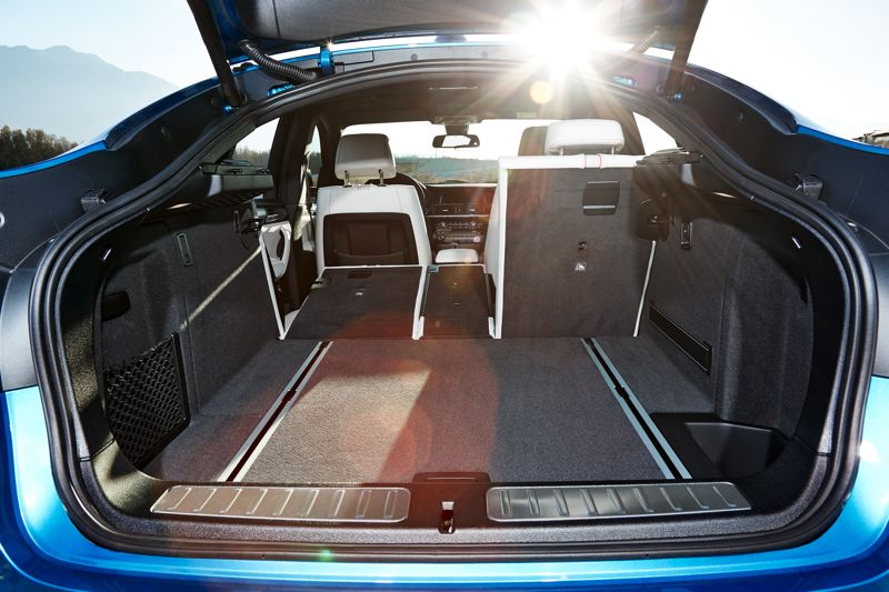 BMW GROUP - Cargo space in the 2017 BMW X4 M40i can be increased by folding down part or all of the back seats.