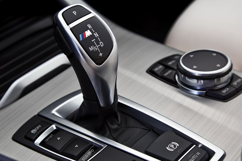 BMW GROUP - The electronic shifter and infotainment system controls are contemporary BMW.