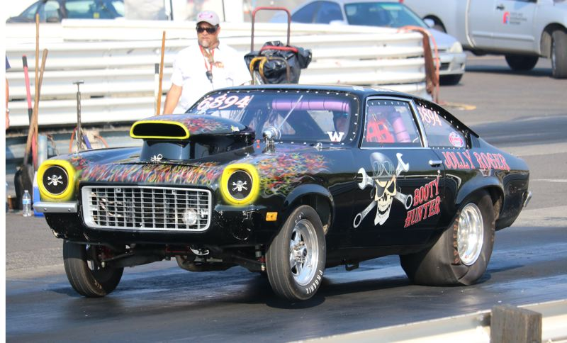 REVIEW/NEWS PHOTO: JIM BESEDA - Happy Valley's Robert Jackson Jr., went from 0 to 105 mph in 6.5 seconds on the eighth-mile straightaway Wednesday at Portland International Raceway.