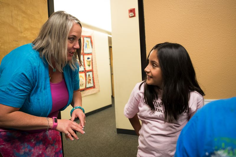 TIMES PHOTO: JAIME VALDEZ - Renee Brouse, executive director of the Good Neighbor Center, visits with Bella, 10, one of the residents at the homeless shelter in Tigard.