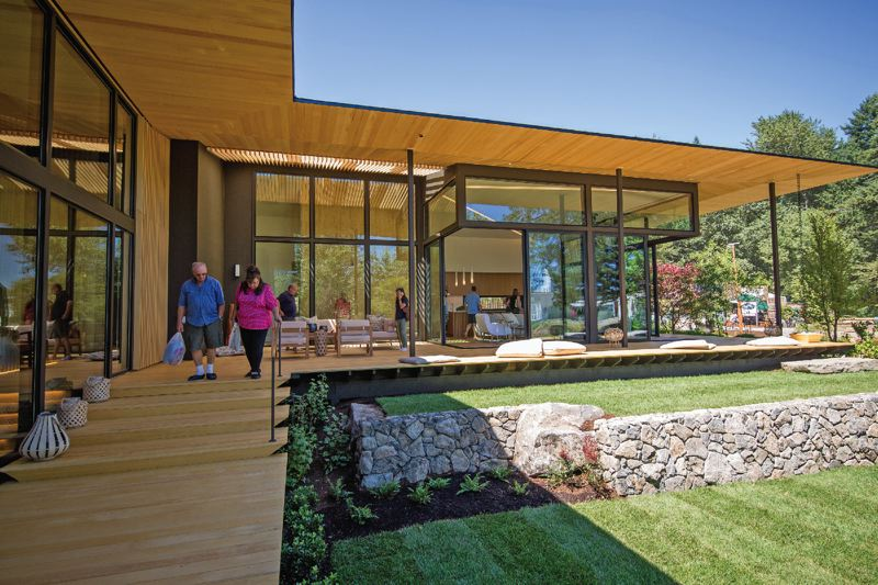 PAMPLIN MEDIA GROUP: ADAM WICKHAM - Kuma's Suteki home at Street of Dreams.The great room and kitchen look out on the pocket Japanese garden, over wooden decks that float above the grass.