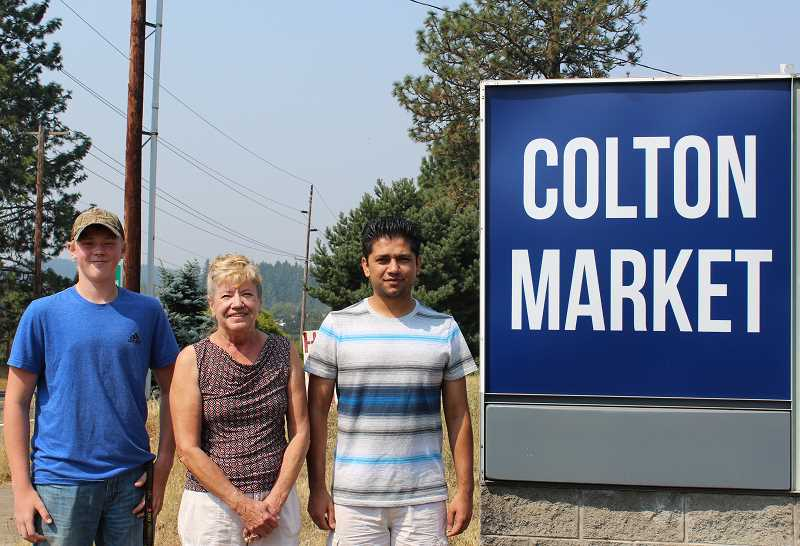 PIONEER PHOTO: KRISTEN WOHLERS - Abdul Saleem (right) values the good people he comes across, like his employees Andy Quinn (left), a gas attendant, and Linda Welch (middle), who has worked at the store for more than 35 years.