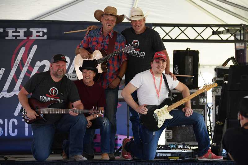 LON AUSTIN - Countryfied celebrates 30 years as a touring band this year. The above photo is from their performance during the Lazy Rockin' Stirrup Ranch Country Fest in Paulina earlier this summer. Pictured left to right, Yancey Fall, John Hite, Mark Mobley, Ron Mobley and Tim Fenderson.