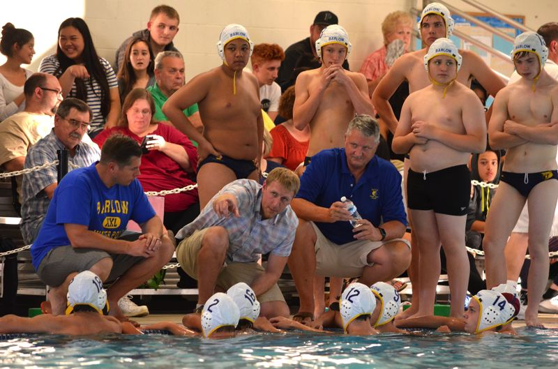 CONTRIBUTED PHOTO - Barlow High water polo coach directs his players in the pool during last years state tournament.