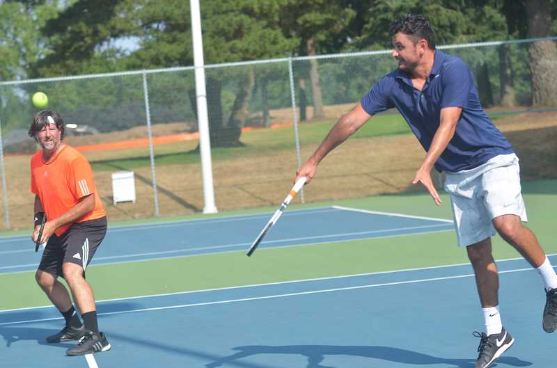 SPOKESMAN PHOTO: COREY BUCHANAN - Former Gonzaga tennis player Marco Pineda hits a volley during the match.