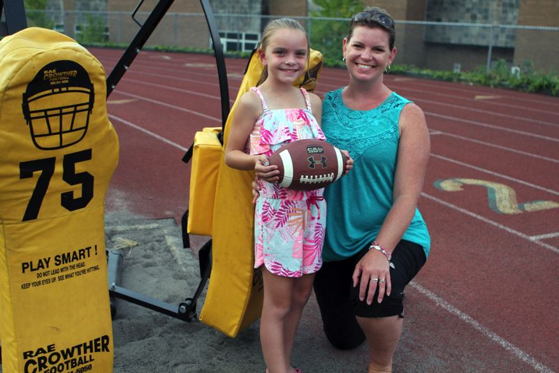 TIDINGS PHOTO: MILES VANCE - Oregon City's Megan Gomez (right) and her daughter Jalea, who suffers from cystic fibrosis, will be part of the dance team that will perform at the 2017 Battle for the Bridge. The annual game, a fundraiser for cystic fibrosis, is scheduled for Aug. 19 at Hillsboro Stadium.