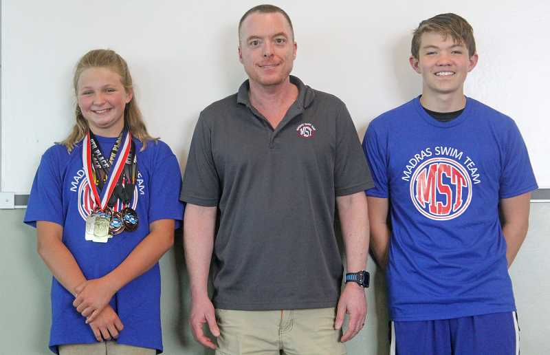 WILL DENNER/MADRAS PIONEER - With their coaches Tim Nelson (center) and Sara Nelson (not pictured), Lexi Williams (left) and Julian Hollingshead (right) are poised to continue developing for years to come.