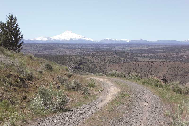 WILL DENNER/MADRAS PIONEER - The last two-mile section of the eight-mile course winds up a dirt and gravel road, known as the Campbell Grade, which connects with the Beamers' ranch at the top.