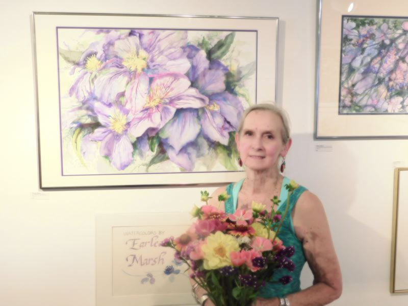ESTACADA NEWS PHOTO: EMILY LINDSTRAND - Earlean Marsh's show at the Spiral Gallery features many watercolor paintings of flowers. The show will hang in the gallery through Sunday, Aug. 27.