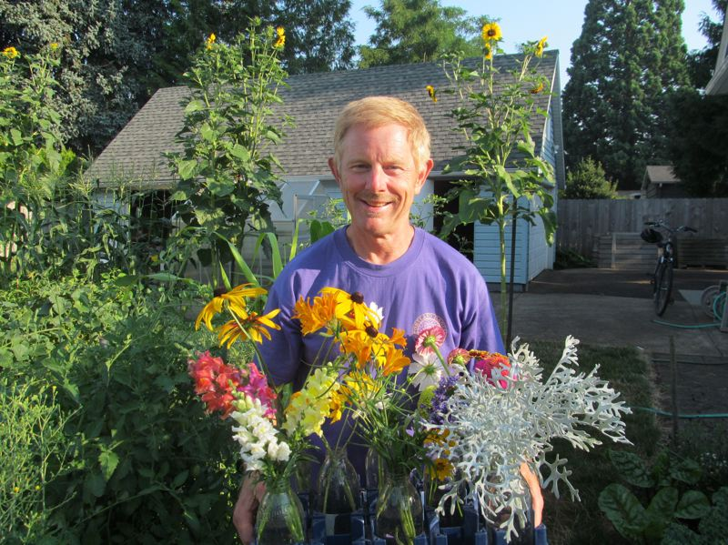 PHOTO BY DICK TRTEK - Larry Smith shows off the floral cuttings he made last week to enter in the Clark County Fair. He will enter 75 floral cuttings in the Clackamas County Fair, opening on Aug. 15.