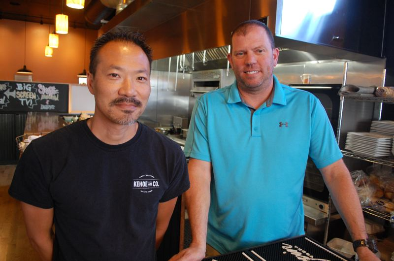 PHOTO BY: RAYMOND RENDLEMAN - Kehoe & Co. Executive Chef Paul Bitter joins Oregon City craft-sausage restaurant owner Mike Kehoe.