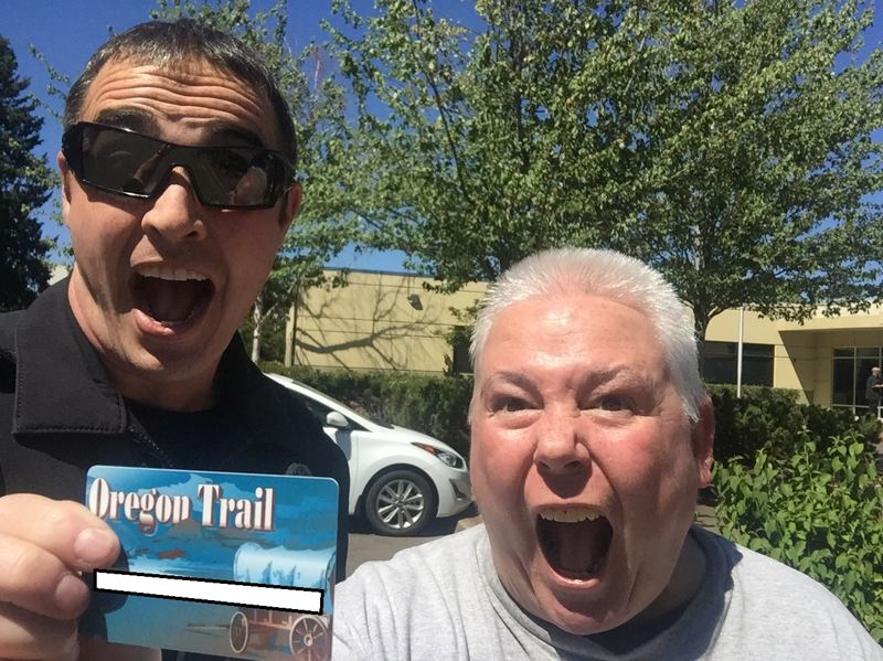PHOTO COURTESY: OCPD - Mike Day, the homeless liaison officer for the Oregon City Police Department, celebrates with Kathy Knox after she got a food-stamp card.