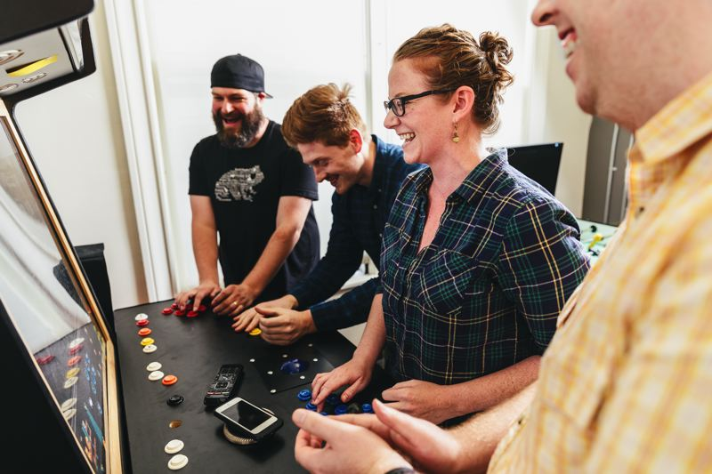 COURTESY: METAL TOAD - Scenes from Metal Toad's Portland office in the Yeon building. Kegerators, games and foosball are a sign of trust by managment, but unlimited paid leave is the golden handcuffs.