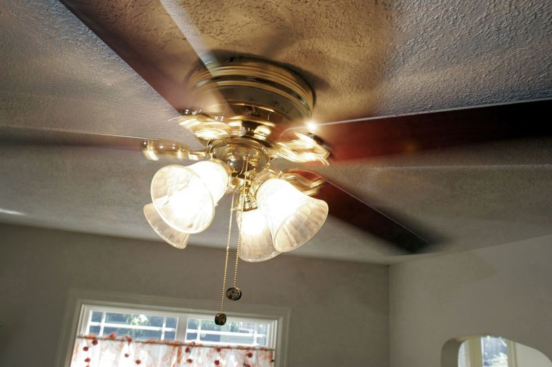 PAMPLIN MEDIA GROUP FILE PHOTO  - A ceiling fan uses relatively little energy but can help cool off a room, and help your air conditioner be more efficient.