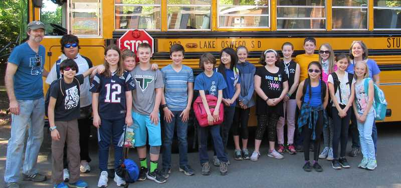 SUBMITTED PHOTO: COURTESY OF UNICEF - Touchstone Elementary School students recently donated $268 to UNICEF. Touchstone is a private school, but sometimes Lake Oswego School District's vast fleet of buses comes in handy.
