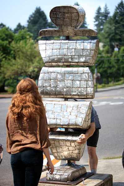 SUBMITTED PHOTO; ARTS COUNCIL OF LAKE OSWEGO - Volunteers install 'Contemplation' on A Avenue near Kyra's Bake Shop in preparation for this weekend's 'Unveil Your Art!'