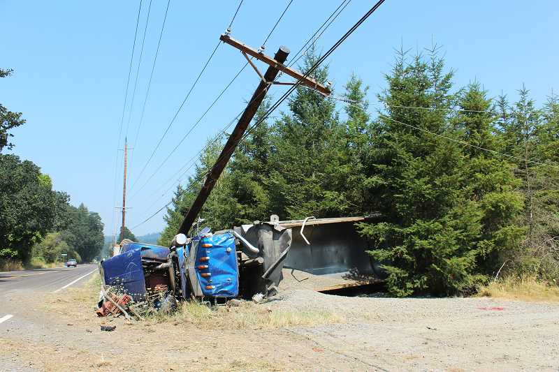PIONEER PHOTO: KRISTEN WOHLERS - A dump truck full of rocks veered off of Highway 211 in a single car crash on Wednesday Aug. 9 at 1:06 p.m.