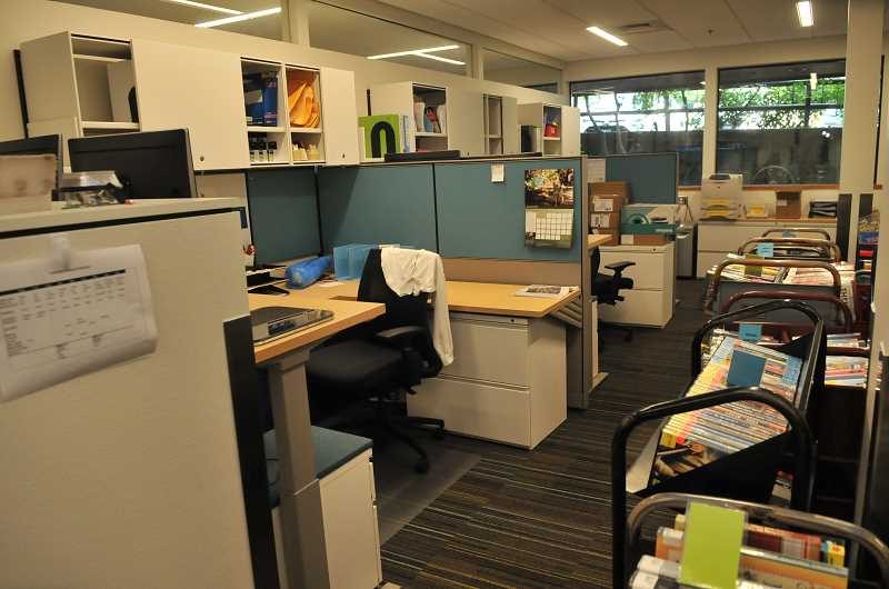 REVIEW PHOTO: VERN UYETAKE - The remodeled staff workroom includes new workstations, offices, furniture and, in another month or two, a state-of-the-art book sorting machine.