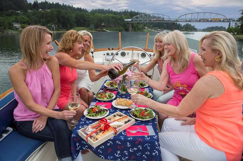 SUBMITTED PHOTO - A group of friends enjoy lunch aboard the True North during a recent afternoon cruise. Complimentary appetizers and non-alcoholic beverages are provided on the nautical adventures; alcohol is welcomed, but must be provided by the passengers themselves.