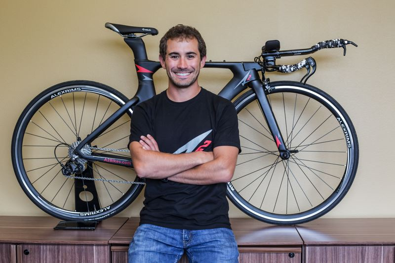 TIMES PHOTO: JONATHAN HOUSE - A-Squared Bikes founder AJ Alley with one of his lower-cost triathalon bikes.