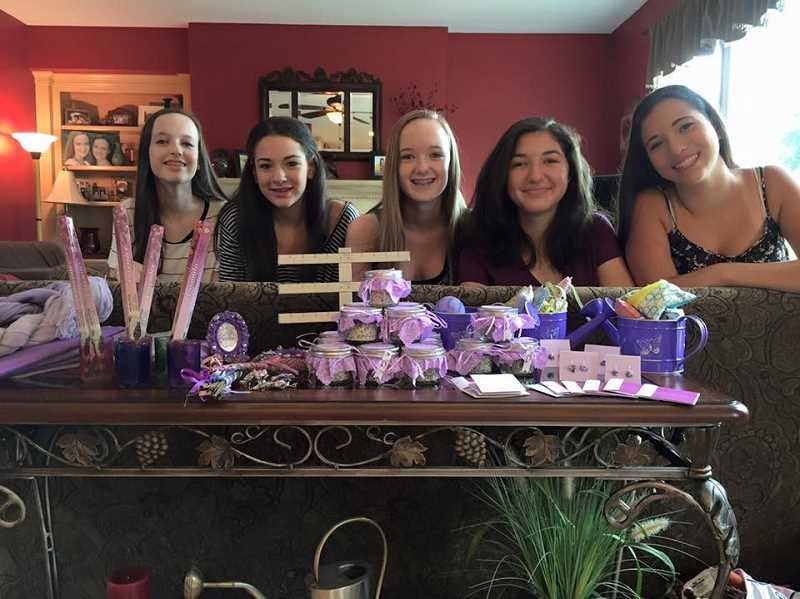 SUBMITTED PHOTO: MICHELLE BOMBET-MINCH - From left: Emily Henning, Audrey Minch, Lauren Henning, Sydney Steinberg and Abigail Minch with some of the of the lavender products theyve created to raise funds for the Childrens Cancer Association.