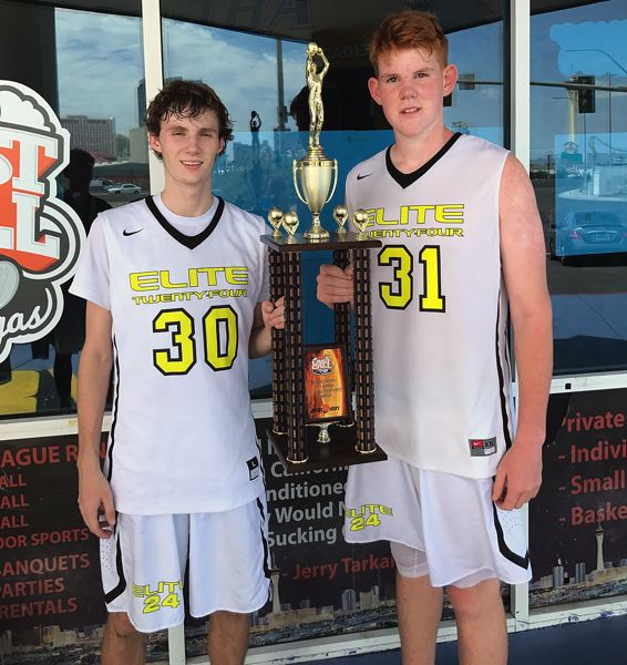 SUBMITTED PHOTO - Jalen Thompson (left) and Ty Horner pose with the tournament championship trophy following their team's win in the Las Vegas Last Chance Bigfoot AAU 17U boys tournament.