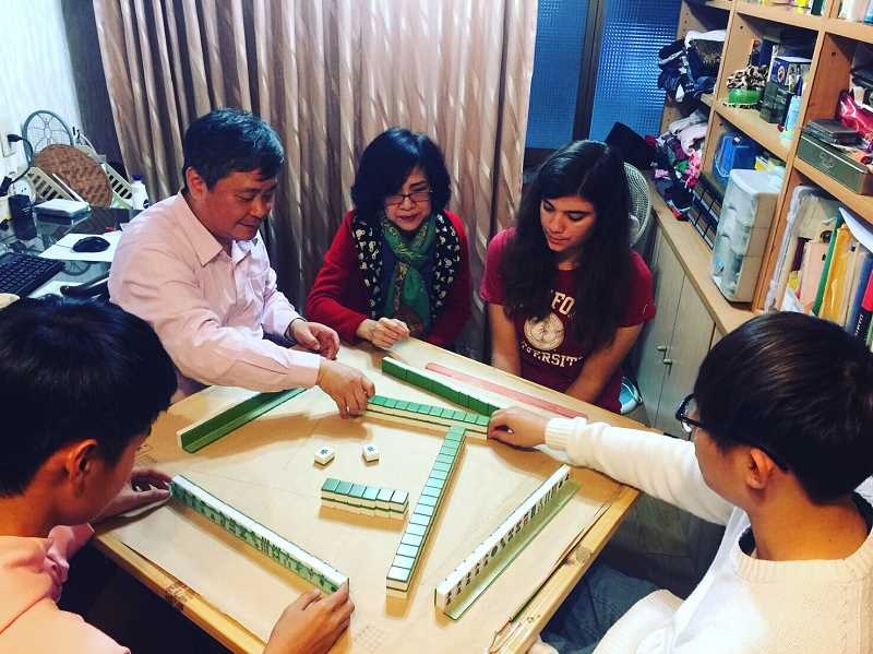 COURTESY ELLA GILBERTSON - Tualatin High incoming senior Ella Gilbertson, second from right, plays a game with her Taiwanese host family.