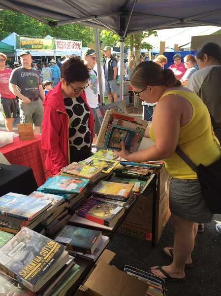 COURTESY BEAVERTON EDUCATION ASSOCIATION - Members of the Beaverton Education Association gave out free gently-used books at the Beaverton Farmers Market last Saturday, in an effort to increase visibility.