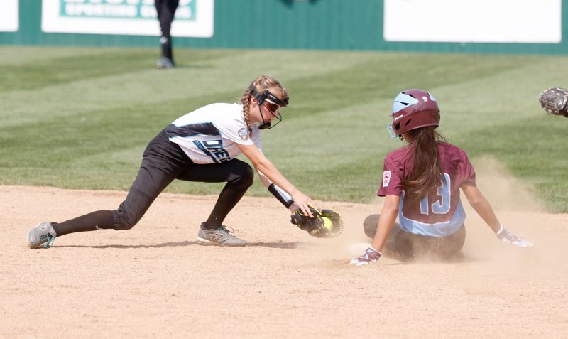 TIMES PHOTO: JON HOUSE - District 4 shortstop Ashley Goodale tries to catch the Southwest team runner at second base.